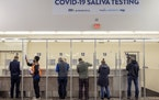 People took saliva COVID-19 tests at a free testing site at the Minneapolis-St. Paul International Airport on Nov. 12, 2020. The Legislative Auditor�