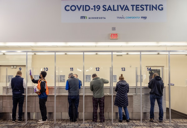People took saliva COVID-19 tests at MSP Airport on Nov. 12, 2020. The Legislative Auditor's Office is looking into complaints about the rates bille