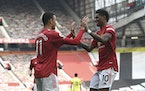 Manchester United's Mason Greenwood, left, celebrated with teammate Marcus Rashford after scoring against Burnley on Sunday. Man U is one of 12 Euro