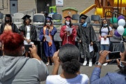 Seniors from various Twin Cities area high schools were celebrated during a drive-in graduation ceremony for graduates with ties to Shiloh Temple on J