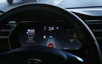 The dashboard of the software-updated Tesla Model S P90D shows the icons enabling Tesla's autopilot, featuring limited hands-free steering. Federal