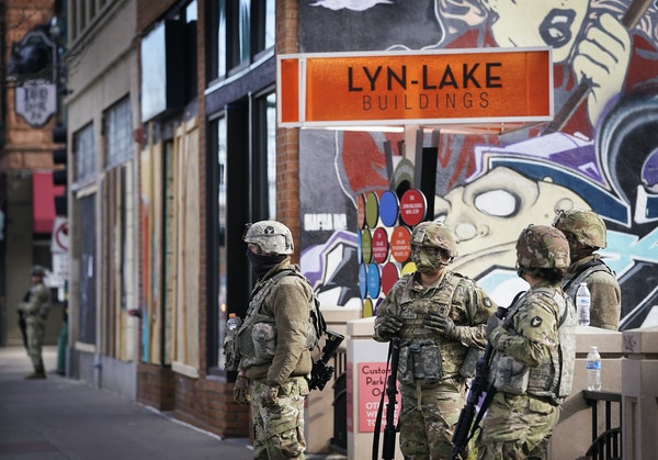 Minnesota National Guard members patrol Lyndale Avenue S. near Lake Street. Twin Cities residents are holding their breaths as they await a verdict in