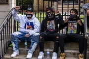 Protesters including Damik Wright, far left, the brother of Daunte Wright attended a rally in front of the governor's residence and proceeded to mar