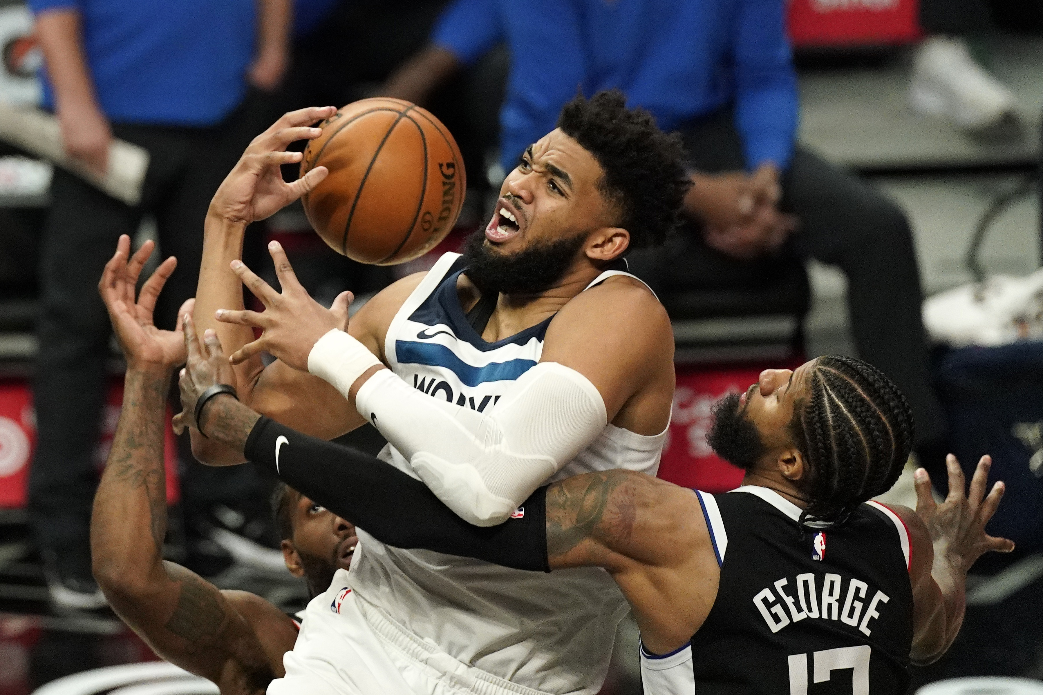 Wolves center Karl-Anthony Towns had the ball knocked from his hands by Clippers guard Paul George during the second half Sunday. Towns injured his right knee in the fourth quarter, but later said it was fine.