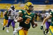 NDSU quarterback Trey Lance runs for a touchdown against Central Arkansas in the third quarter of an NCAA college football game Saturday, Oct. 3, 2020