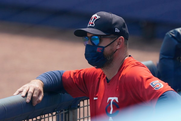 Minnesota Twins manger Rocco Baldelli watches from the dugout during a spring training baseball game against the Tampa Bay Rays Wednesday, March 24, 2