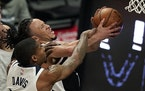 Clippers guard Amir Coffey attempted to shoot as Timberwolves center Ed Davis defended Sunday.