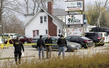 Officials investigate the scene of a deadly shooting at Somers House Tavern in Kenosha, Wis., Sunday, April 18, 2021. Several people were killed and t