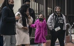 George Floyd's daughter Gianna Floyd (with pink jacket) arrived at the Hennepin County courthouse on the day of closing arguments in the trial of De