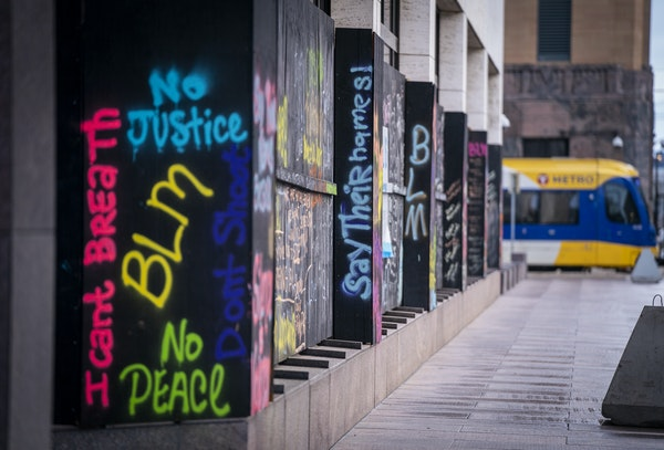 Graffiti covers the boarded-up windows on the U.S. Bank building in Minneapolis on April 12.