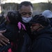 The Rev. Jesse Jackson hugged protesters as he stopped by a demonstration outside the Brooklyn Center police station on Saturday.