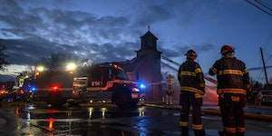 Firefighters worked on putting out a fire at the Sacred Heart of Jesus church in Northeast Minneapolis on Monday, April 19.