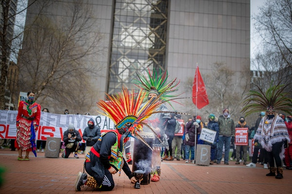 Members of the Kalpulli Yaocenoxtli, a traditional Mexica-Aztec group, blessed the Hennepin County Government Center plaza before a protest march Mond