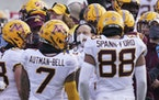 Minnesota head coach P.J. Fleck, center, talks to his players during a time out in the second half of an NCAA college football game against Nebraska,