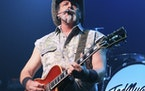 Ted Nugent performs at Rams Head Live in Baltimore on Aug. 16, 2013. Nugent revealed he was in agony after testing positive for coronavirus — months