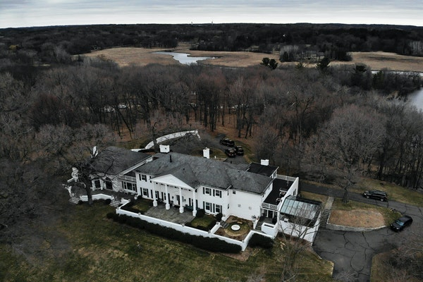 A neighbor is suing the estate of the late Minnesota businessman Irwin Jacobs and the city of Orono over a preliminary plan to divide part of Jacob'