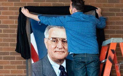 Vice President Walter Mondale's portrait was draped with a black sash Tuesday morning at the University of Minnesota Law School. The building is nam