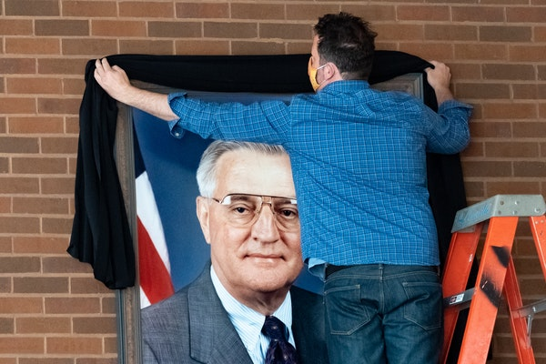 Vice President Walter Mondale's portrait was draped with a black sash Tuesday morning at the University of Minnesota Law School. Mondale Hall is nam