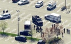 This aerial photo shows police responding to the scene of a shooting at a Stop & Shop supermarket in West Hempstead, N.Y., on Tuesday, April 20, 2021.