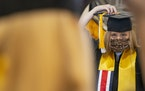 Mariah Fitch prepared for photos at a University of Minnesota Duluth graduation celebration. The ceremony will be virtual.
