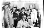 August 14, 1985 In Group 1935, Secretary of Labor Frances Perkins Stands behind president Franklin Roosevelt as he signs the social security Act.   Fe