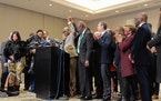 Attorney Ben Crump raised the arm of George Floyd's brother, Philonise Floyd, in celebration as family members held a news conference Tuesday afte