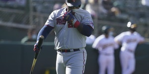 Miguel Sano walks to the dugout after striking out against the Oakland Athletics during the fourth inning