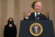 Vice President Kamala Harris, left, listens as President Joe Biden delivers remarks on the guilty verdict against Derek Chauvin, at the White House in