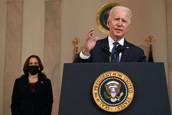 Vice President Kamala Harris, left, listens as President Joe Biden delivers remarks on the guilty verdict against Derek Chauvin, at the White House in