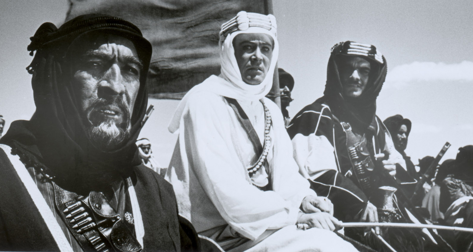 Anthony Quinn (left) stars as Auda abu Tayi, Peter O'Toole (center) as T.E. Lawrence, and Omar Sharif (right) as Sherif Ali ibn Kharish, as they wage war against the Turks, in 'Lawrence of Arabia.'