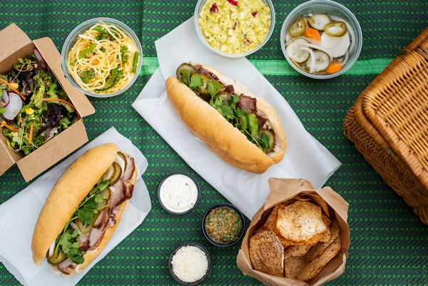 Vinai's picnic kit includes bahn mi and a selection of sides.