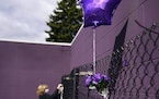 A balloon floated in the breeze on a remembrance fence outside Paisley Park Wednesday as Diane Maus of Lino Lakes put up a poem she wrote to Prince.