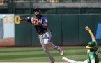 Twins second baseman Luis Arraez threw to first after forcing out Oakland's Seth Brown on Wednesday.