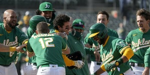Ramon Laureano, center, celebrated with Oakland teammates after Wednesday's victory.
