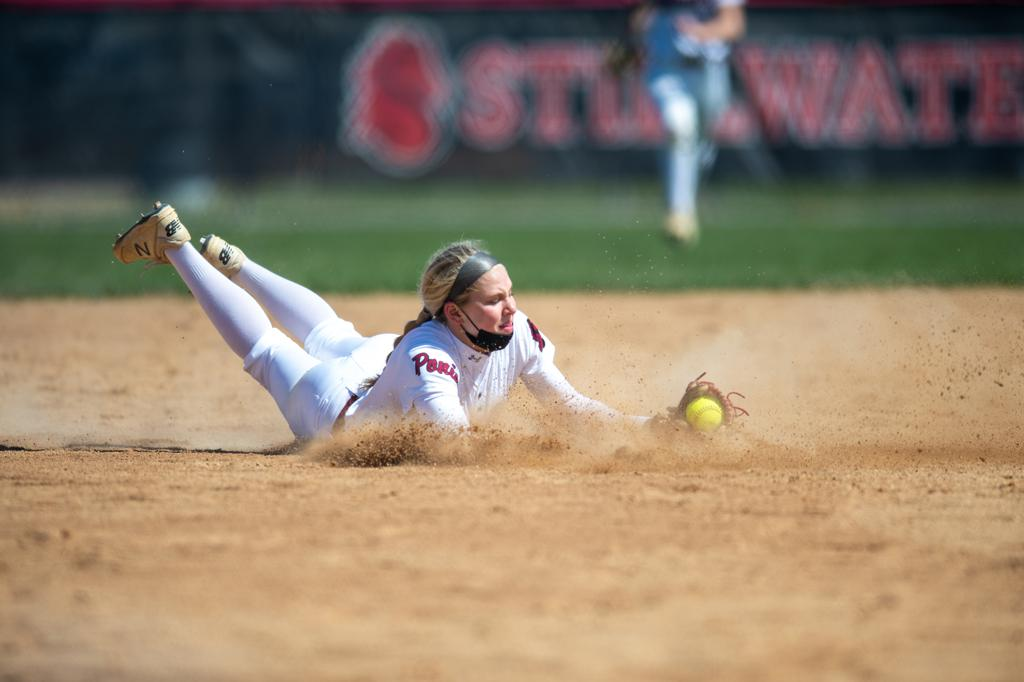 Stillwater shortstop Morgan Wohlers made a diving catch in an April 17 game against Elk River played at Stillwater.