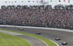 Fans watch the running of the Indianapolis 500 in the first turn at Indianapolis Motor Speedway in Indianapolis, in 2017