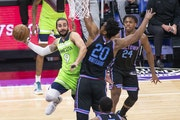 Timberwolves guard Ricky Rubio is defended by Sacramento Kings center Hassan Whiteside during the first quarter