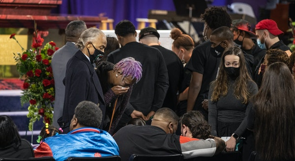 The Rev. Al Sharpton, left, with Daunte Wright's grandmother Angie Golson and parents Aubrey and Katie Wright, seated, during a wake Wednesday night