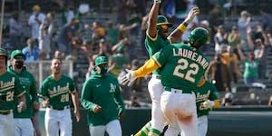 Oakland Athletics' Ramon Laureano (22) celebrates with Tony Kemp (5) Wednesday.
