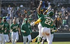 Oakland Athletics' Ramon Laureano (22) celebrates with Tony Kemp (5) Wednesday.