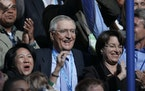 Former Vice President Walter Mondale, center, and Sen. Amy Klobuchar, D-Minn., right, during the roll call of states on the third day of the Democrati