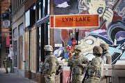 Minnesota National Guard members patrolled Lyndale Avenue S. near Lake Street in Minneapolis on Friday.  DAVID JOLES • david.joles@startribune.com