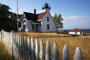 The West Chop Light and Coast Guard Station are shown, Sunday, June 28, 2020 in Tisbury, Mass. on the island of Martha's Vineyard. The lighthouse wa