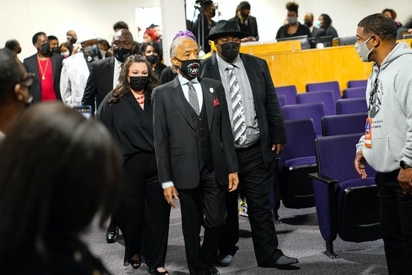 Rev. Al Sharpton, is followed by Katie and Aubrey Wright, parents of Daunte Wright, during Daunte's funeral services in Minneapolis on Thursday, Apr