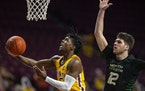 Gophers guard Marcus Carr drove to the basket past North Dakota forward Filip Rebraca December 4