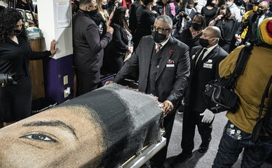 Daunte Wright's casket was removed from the church at Shiloh Temple International Ministries on Thursday in Minneapolis. His family is walking behin
