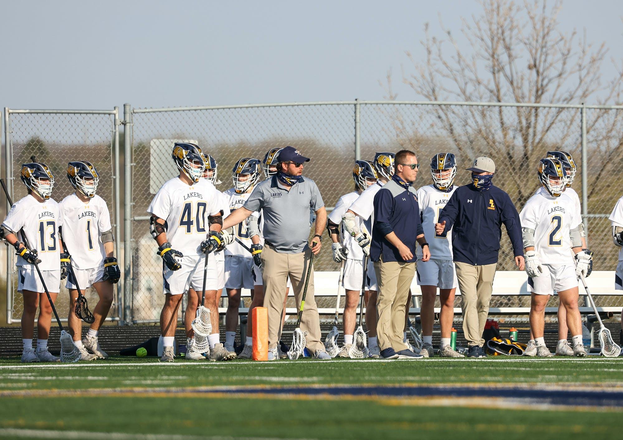 Prior Lake lacrosse coach Casey Mithun, far right.