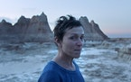 "This image released by Searchlight Pictures shows Frances McDormand in a scene from the film ""Nomadland."""
