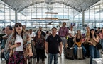 Travelers at Hong Kong International Airport, where a general strike grounded almost 200 flights, most of them with Cathay Pacific, in Hong Kong, Aug.