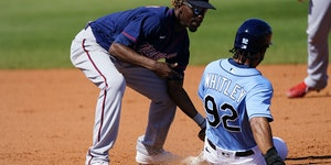 Nick Gordon tagged out a runner during a spring training game.